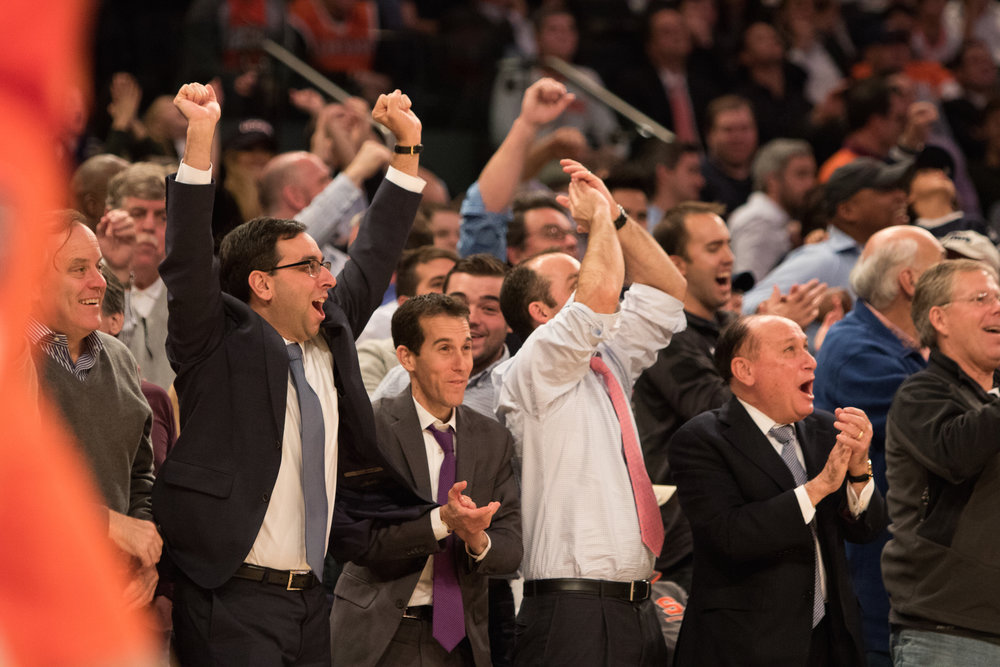 UConn fans celebrate the Huskies' 52-50 win on the sidelines. Christian Vital made 2 free throws with 2.2 seconds left to seal the win. (Jackson Haigis/The Daily Campus)