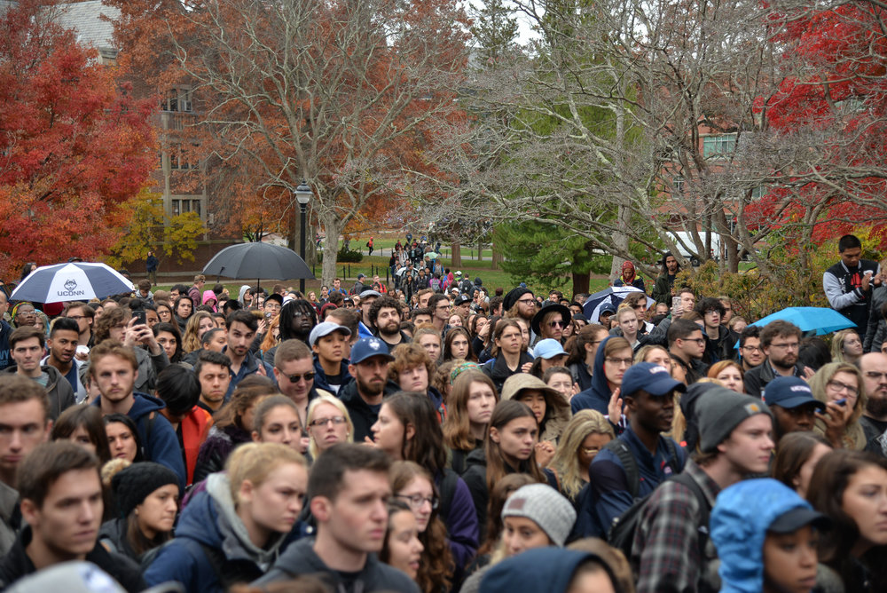 UConn students and faculty gather in front of Wilbur Cross to show their support for marginalized students during the Rally for the People on Wednesday, Nov. 9, 2016. The UConn branch of the AAUP voted endorse a community petition to support undocumented students. (Amar Batra/The Daily Campus)