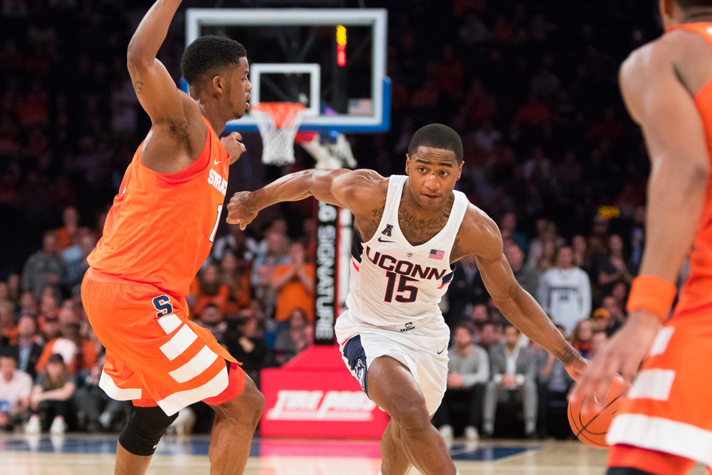 Senior guard Rodney Purvis (15) maneuvers around Syracuse defenders during the Huskies 52-50 victory over the Orange at Madison Square Garden on Monday, Dec. 6, 2016. The win showed that the team has the potential to turn-around the season. (Jackson Haigis/The Daily Campus)