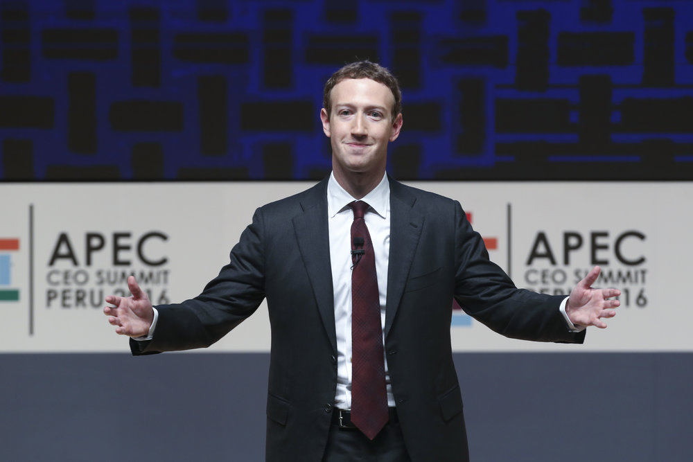 Mark Zuckerberg, chairman and CEO of Facebook, speaks at the CEO summit during the annual Asia Pacific Economic Cooperation (APEC) forum in Lima, Peru, Saturday, Nov. 19, 2016. Recently Facebook has received a lot of criticism for the prevalence of fake news articles showing up on users' newsfeeds.  (Esteban Felix/AP)