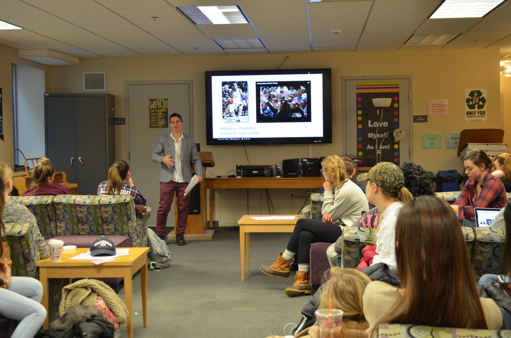 Students at the Rainbow Center listen to Erin Buzuvis discuss how Title IX protects the civil rights of LBGT athletes and coaches on Dec. 7, 2016. Buzuvis is a Professor of Law at Western New England University; her topics of interest include sex, gender, and sexual orientation discrimination. (Akshara Thejaswi/The Daily Campus)