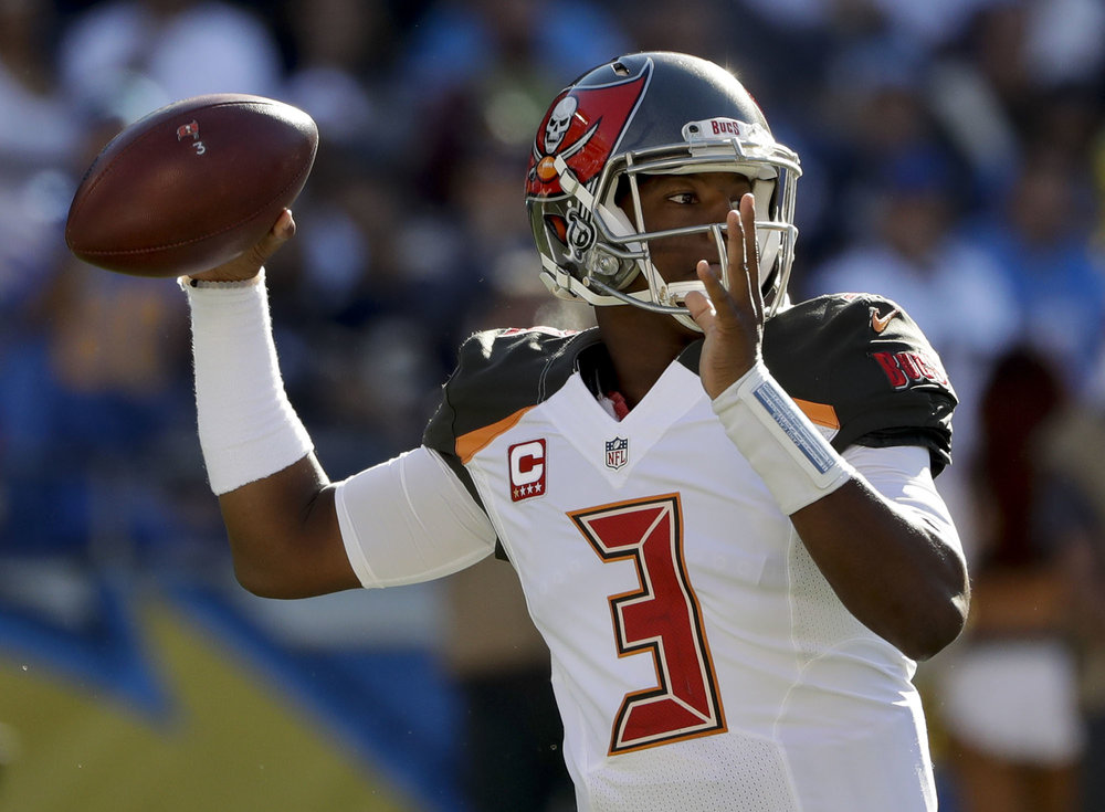 Tampa Bay Buccaneers quarterback Jameis Winston passes against the San Diego Chargers during the first half of an NFL football game Sunday, Dec. 4, 2016, in San Diego. (Gregory Bull/AP)