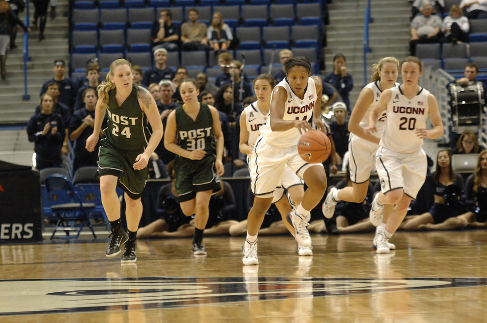 Pictured: UConn vs Post University in the 2014 exhibition game.  In 2014, UConn freshman Sadie Edwards transferred to USC after playing six games in order to receive more play time.  (Stephen Quick/ The Daily Campus)