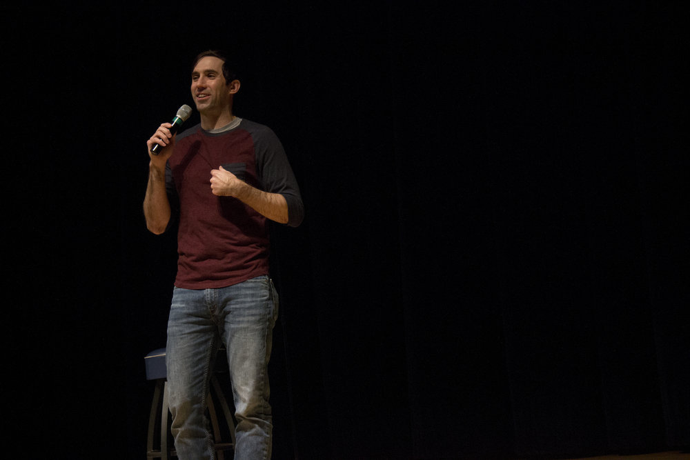 Stand up comic Michael Palascak performs in the Student Union Theatre on Wednesday, Dec. 7, 2016, giving UConn students one final laugh of the semester. (Mustafe Mussa/The Daily Campus)