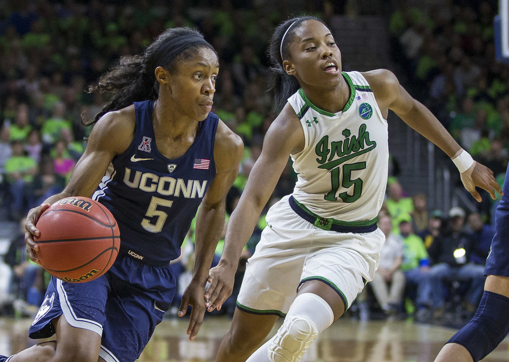 Connecticut's Crystal Dangerfield (5) drives by Notre Dame's Lindsay Allen (15) during the second half of an NCAA college basketball game Wednesday, Dec. 7, 2016, in South Bend, Ind. Connecticut won 72-61. (Robert Franklin/AP)