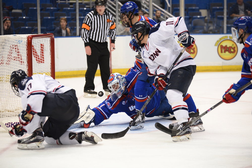 UConn's Corey Ronan (#11) and Jesse Schwartz (#17) attack the net in a game against UMass Lowell at the XL Center. (Zhelun Lang/The Daily Campus)