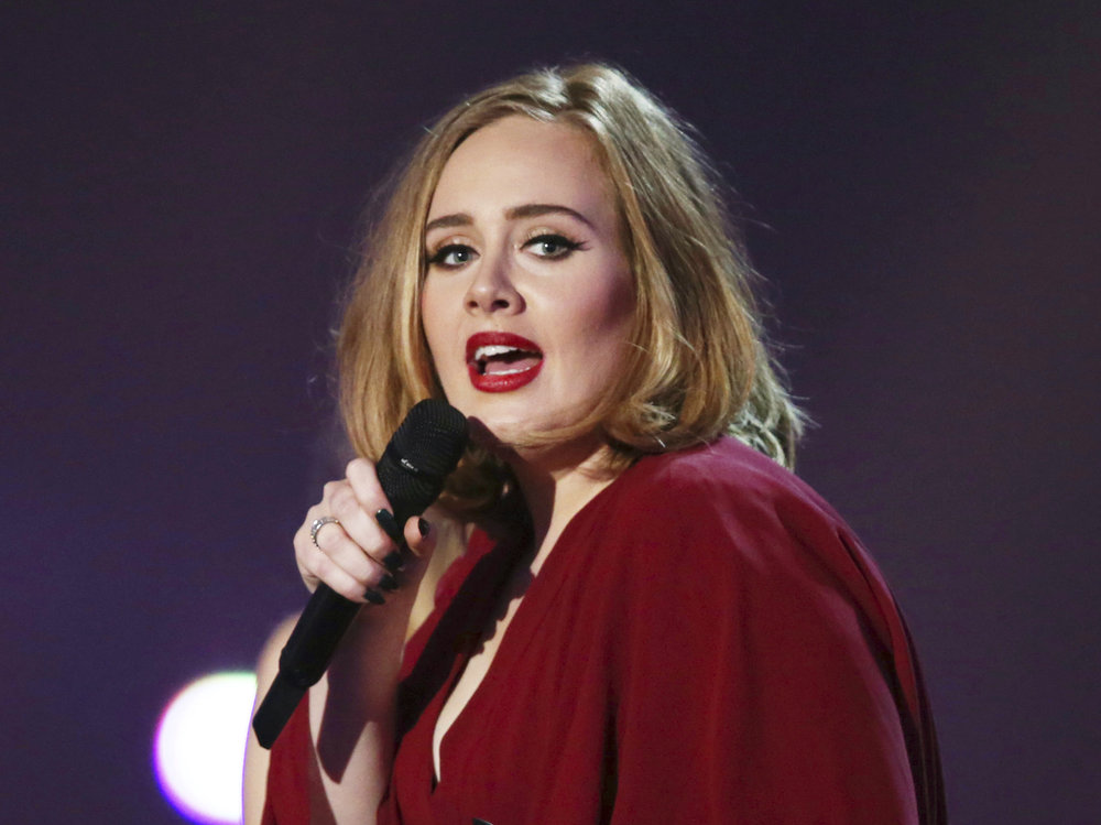 In this Feb. 24, 2016 file photo shows Adele onstage at the Brit Awards 2016 at the 02 Arena in London. Adele, who has five Grammy nominations, announced Tuesday, Dec. 6, including album, song and record of the year. (Joel Ryan/Invision/AP, File)