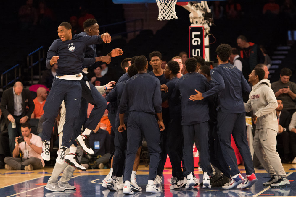 UConn senior Rodney Purvis (left) gets airborne during the Huskies' warm-up before their game against Syracuse at Madison Square Garden on Monday, Dec. 5, 2016. Purvis had 10 points and six rebounds in UConn's 64-60 loss to Ohio State on Saturday, Dec. 10. (Jackson Haigis/The Daily Campus)
