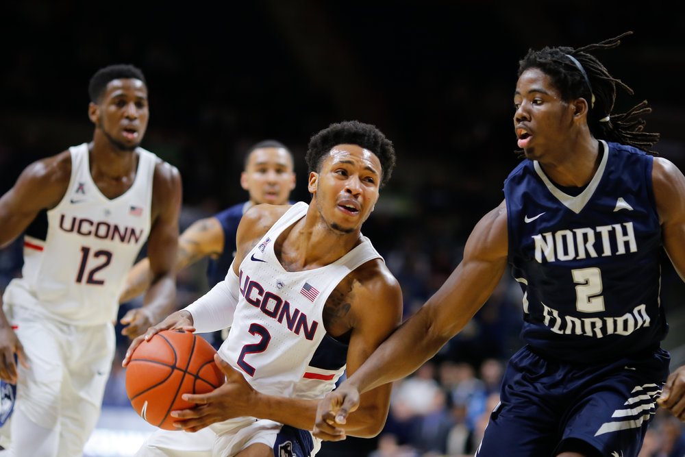 UConn guard Jalen Adams (2) drives past a defender during a 80-59 win over North Florida Sunday at Gampel Pavilion in Storrs, Conn.