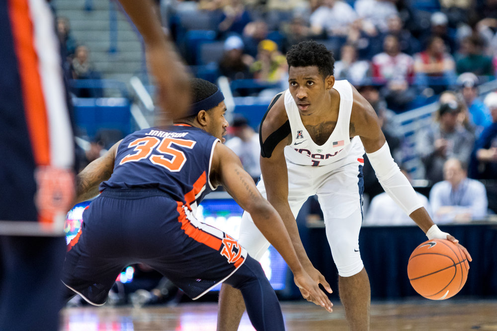 Christian Vital stares down an Auburn defender during a 70-67 overtime loss on Friday, Dec. 23 at the XL Center in Hartford. Vital finished the day with only three points and four rebounds, going 1-6 from the field and 1-5 from three. (Jackson Haigis/The Daily Campus)
