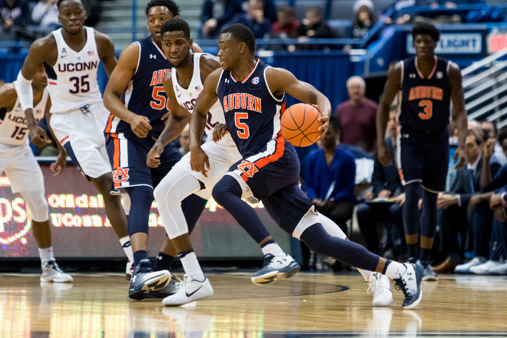 Auburn guard Mustapha Heron drives to the rim during Friday's 70-67 win over UConn at the XL Center in Hartford. (Jackson Haigis, Photo Editor/The Daily Campus)