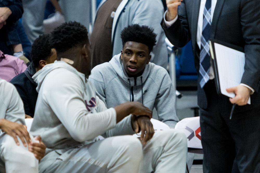 UConn recruiting target Hamidou Diallo (right) talks with UConn forward Mamadou Diarra (left) during Friday's 70-67 loss to Auburn at the XL Center in Hartford. (Jackson Haigis, Photo Editor/The Daily Campus)