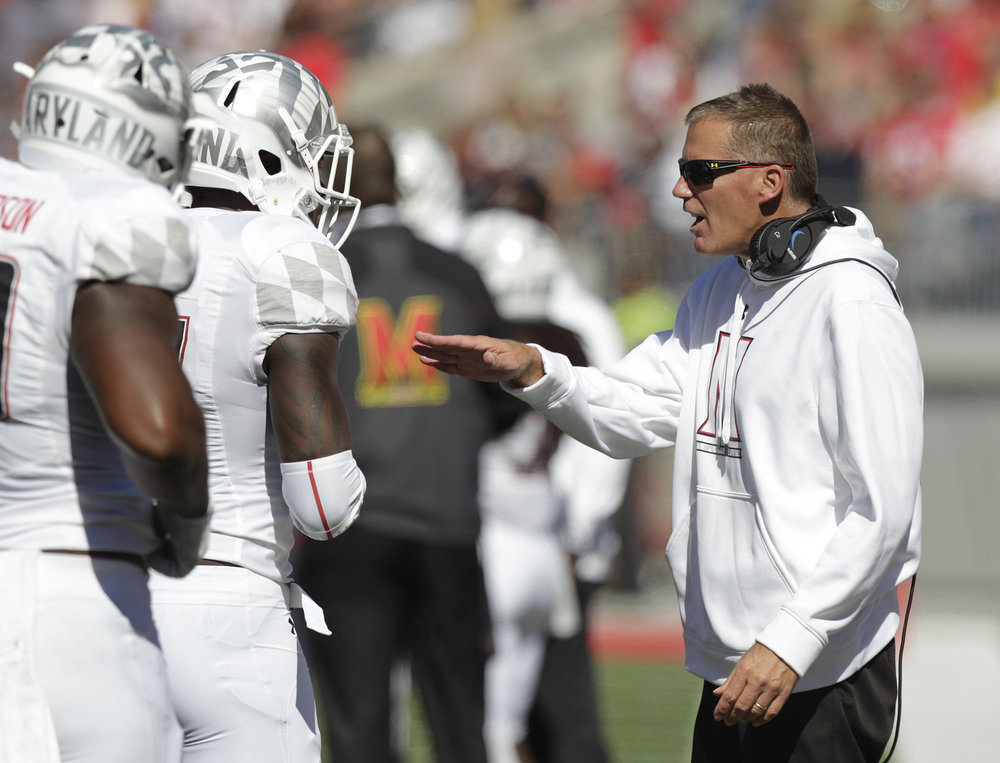 Former Maryland head coach Randy Edsall instructs his team against Ohio State during the second quarter of an NCAA college football game Saturday, Oct. 10, 2015, in Columbus, Ohio. Edsall was hired to return to the helm of UConn football just days following the firing of Bob Diaco. (Jay LaPrete/AP)