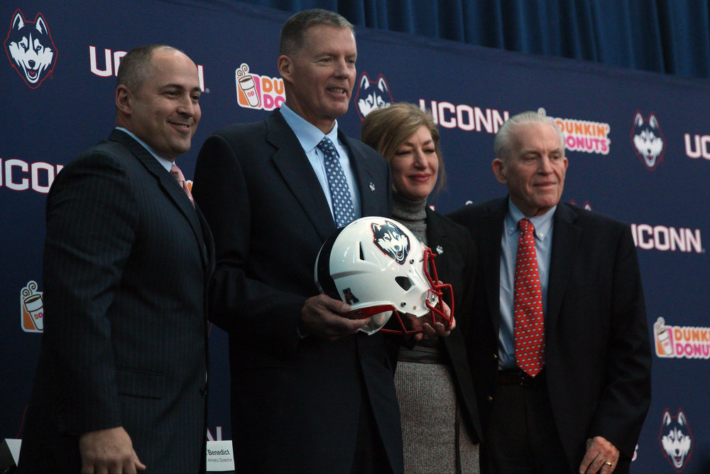 From left to right: Athletic Director David Benedict, new hire Randy Edsall, university president Susan Herbst, and Chairman of the Board of Trustees Larry McHugh. New football head coach Randy Edsall, who coached UConn from 1999-2010, addressed the media at Rentschler Field on Friday, Dec. 30 in East Hartford. Edsall is the winningest coach in UConn history and will officially become head coach on Jan. 3, 2017. (Photo courtesy of Ian Bethune/The UConn Blog)