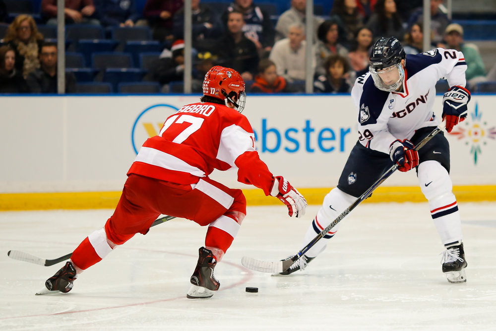 UConn's Tage Thompson skates by a Boston University defender in the Huskies' 2-1 loss to the Terriers at the XL Center in Hartford, Connecticut on Nov. 18, 2016. (Tyler Benton/The Daily Campus)