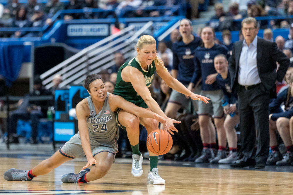 Napheesa Collier dives for a loose ball in the Huskies' 102-37 win over No. 20 USF at the XL Center on Jan. 10, 2017. (Owen Bonaventura/The Daily Campus)