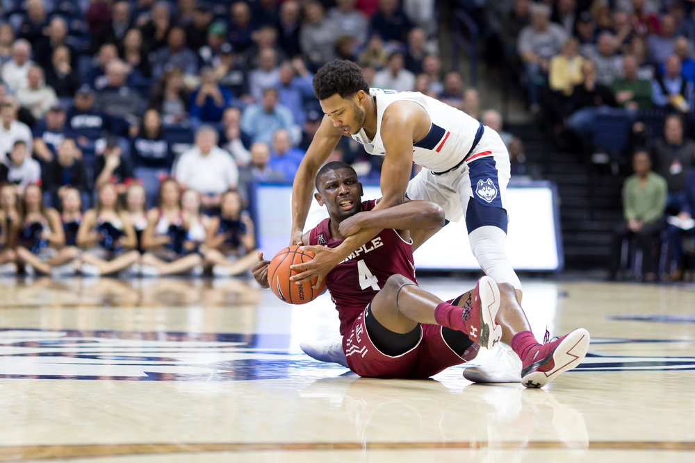 Jalen Adams fights for possession after turning the ball over in a 73-59 win over Temple on Wendesday, Jan. 11 at Gampel Pavilion. (Tyler Benton/The Daily Campus)