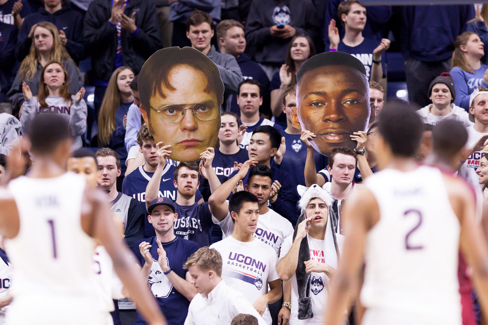 Students hold up fatheads during UConn's 73-59 win over Temple on Wendesday, Jan. 11 at Gampel Pavilion. (Tyler Benton/The Daily Campus)