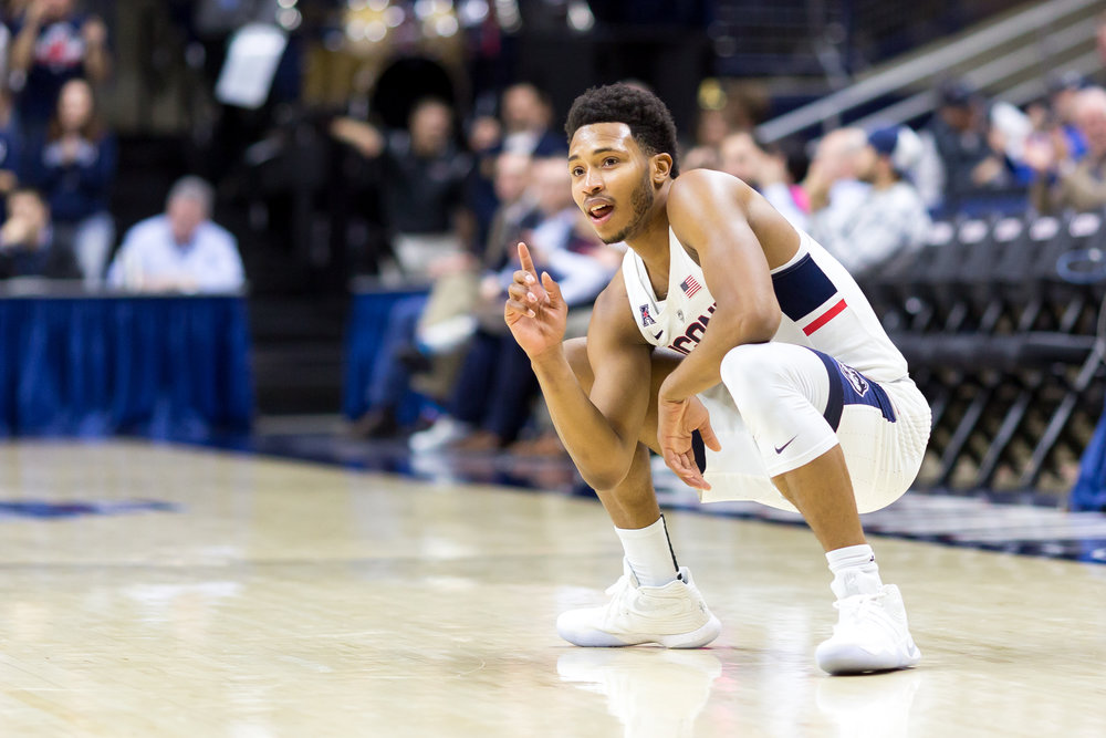 Jalen Adams poses as he takes a moment of rest on the floor during UConn's 73-59 win over Temple on Wednesday, Jan. 11 at Gampel Pavilion. Adams finished with a career-high 12 assists and said that his teammates help set him up to play better. (Tyler Benton/The Daily Campus)