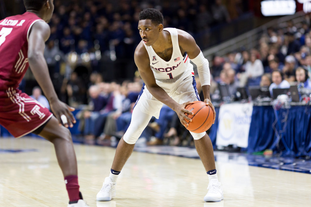 Freshman Christian Vital controls the ball against a Temple defender during UConn's 73-59 win over Temple on Wednesday, Jan. 11, 2017 at Gampel Pavilion. Vital collected only five points and three rebounds in UConn's loss to Georgetown on Saturday, Jan. 14, 2017. (Tyler Benton/The Daily Campus)