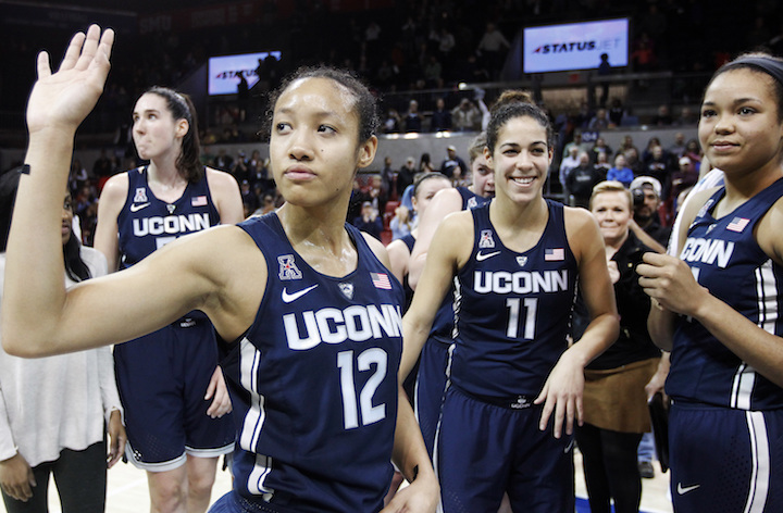 Connecticut guard Saniya Chong (12) and her teammates wave to fans after an NCAA college basketball game against SMU, Saturday, Jan. 14, 2017, in Dallas. Connecticut won 88-48, their 91st straight win. (Brandon Wade/AP Photo)