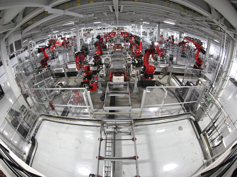 Robots build cars in a Tesla facility. More and more labor jobs are disappearing due to more efficient machinery. (Steve Jurvetson/Flickr Creative Commons)