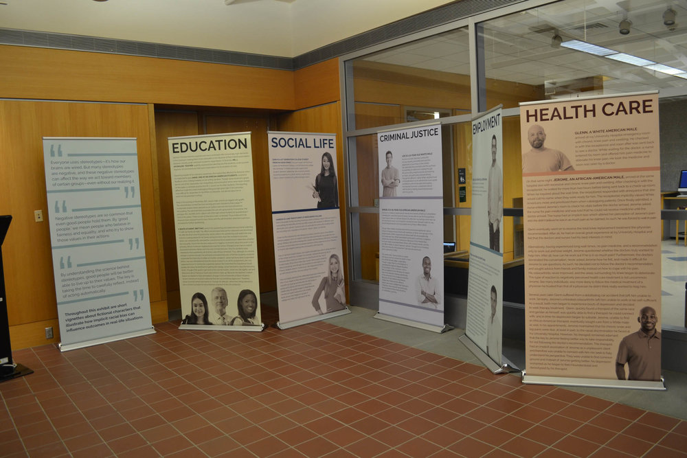 The Implicit Bias Exhibit, which officially opens on January 23, is in the ground level of the library. The exhibition challenges students to look beyond appearances and preconceived judgments in order to become more open minded. (Olivia Stenger/The Daily Campus)