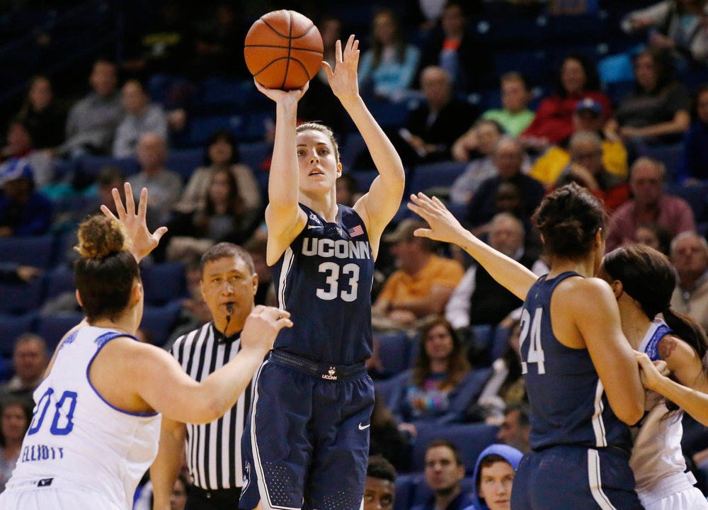 Connecticut's Katie Lou Samuelson (33) shoots in front of Tulsa forward Kendrian Elliott (00), UConn's Napheesa Collier (24) and Tulsa's Ebony Parker, right, during the first quarter of an NCAA basketball game in Tulsa, Okla., Tuesday, Jan. 17, 2017. (Sue Ogrocki/AP)