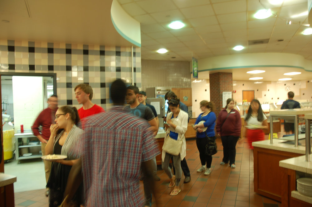 Students wait in line in South Campus dining hall. South is home to the new half-mushroom, half-beef burger that one writer found unimpressive. (Carly Zaleski/The Daily Campus)