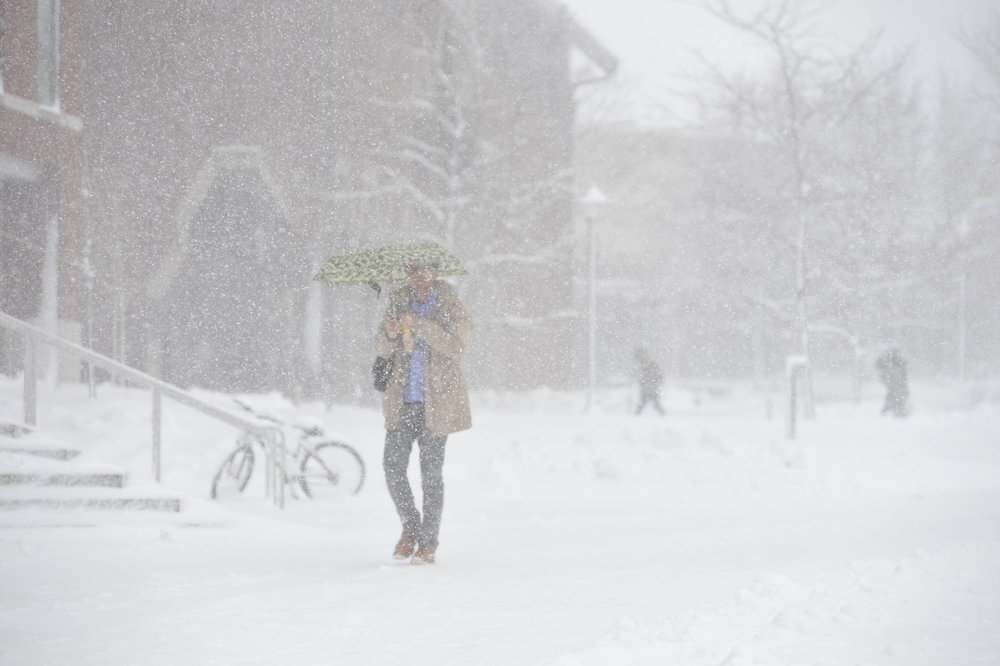 A student walks through Fairfield Way in the middle of a winter storm. Winters at UConn see tempters far below the single digits, which can discourage students from attending class. (Jason Jiang/The Daily Campus)