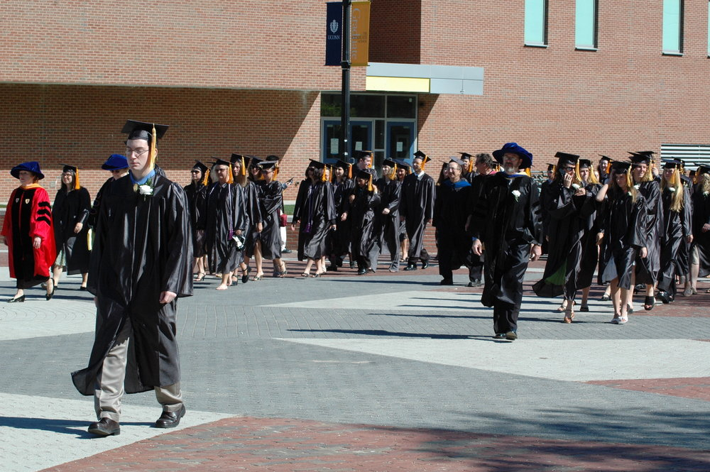 Students walk down Fairfield Way on their way to graduate. Students looking to graduate in May 2017 should check that they meet the necessary requirements. (File Photo/The Daily Campus)