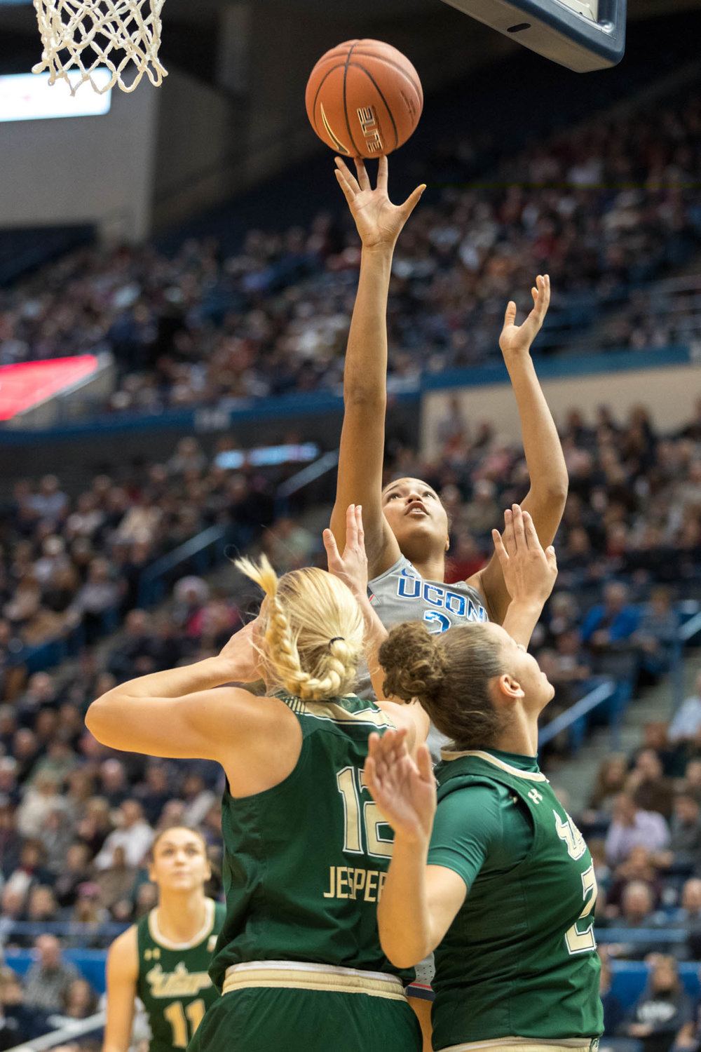 Sophomore guard Napheesa Collier floats a shot above two USF defenders during the Huskies historic 90 win on Jan. 10, 2016 at the XL Center in Hartford. (Owen Bonaventura/The Daily Campus)