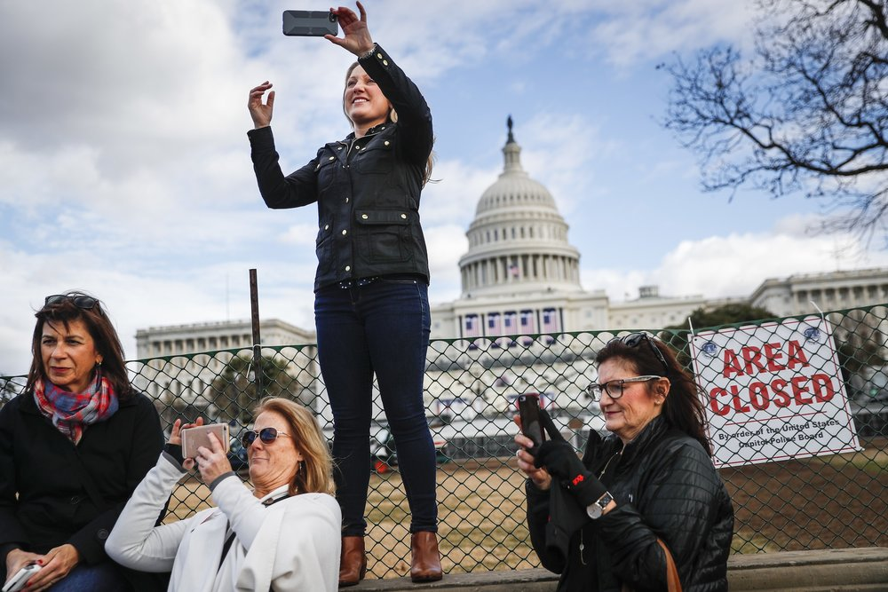 Micaela Johnson, of Leewood, Kan., in town to take part in Saturday's Women's March on Washington, takes a selfie with the Capitol Building in the background as preparations continue for Friday's presidential inauguration, Wednesday, Jan. 18, 2017, in Washington. (John Minchillo/ AP)
