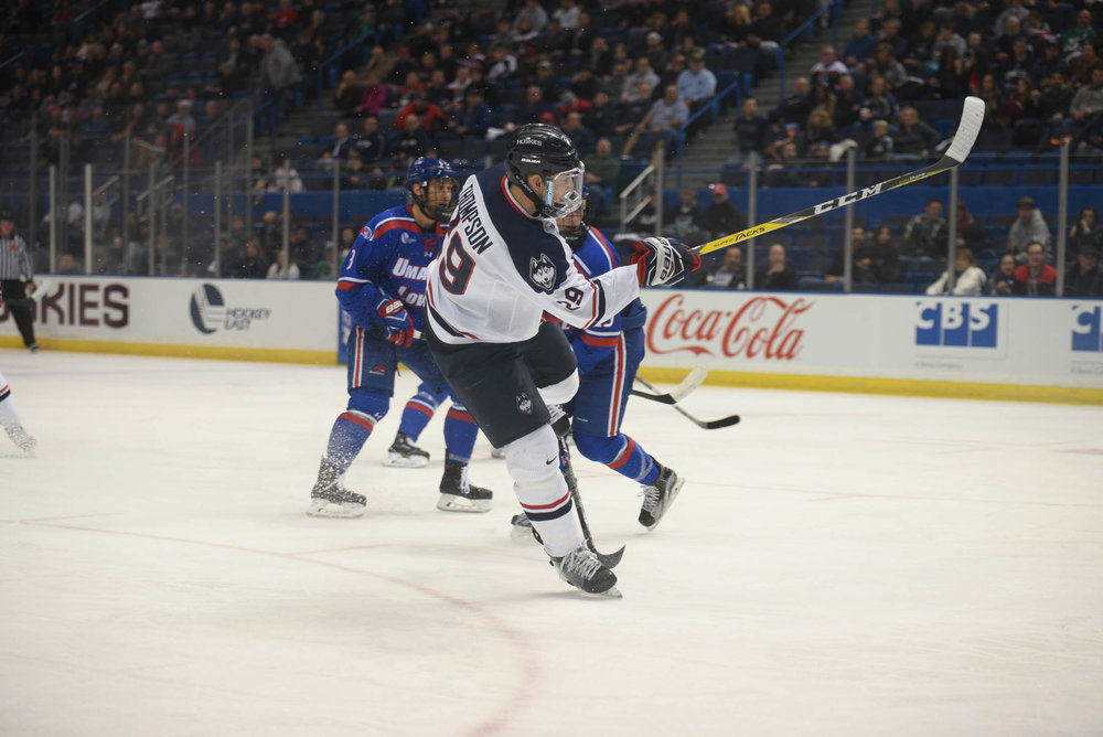 UConn forward Tage Thompson fires a shot as the Huskies tie nationally ranked UMass Lowell Saturday, Dec. 2, 2016 at the XL center with a overall score of 2-2. (Zhelun Lang/The Daily Campus)