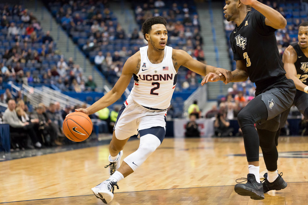 UConn guard Jalen Adams (2) dribbles past a UCF defender during the Huskies 64-49 victory over the Knights on Jan. 8, 2016 at the XL Center in Hartford. (Tyler Benton/The Daily Campus)
