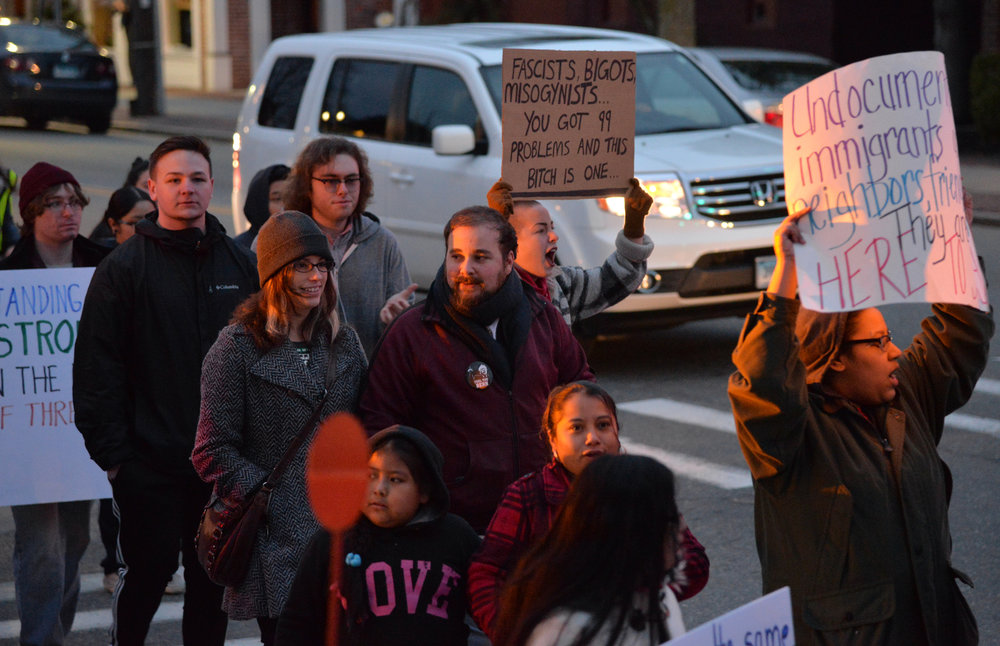 "Windham residents gather in Willimantic to show their support for undocumented students and immigrants in the face of Donald J Trump's inauguration at the ""March and Rally for Undocumented Immigrant Rights"" on Friday, Jan. 20, 2017. (Amar Batra/The Daily Campus)"