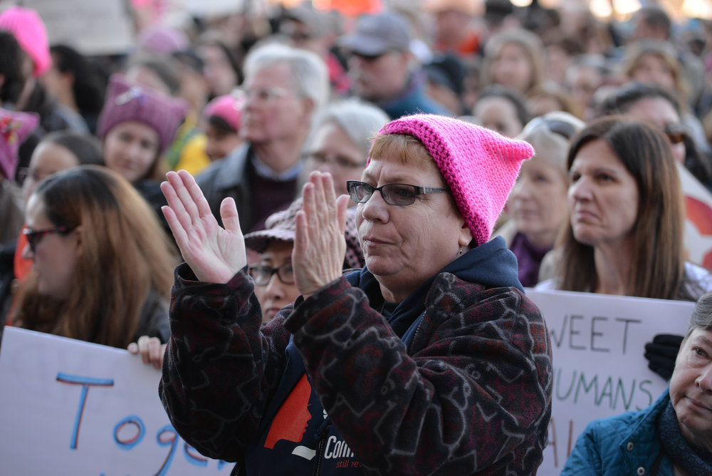 "A woman wearing a ""pussycat"" cap cheers along during the ""Women's March on Hartford, CT: In Solidarity with Washington"" on Saturday, Jan. 21, 2016 on the steps of the State Capitol. (Amar Batra/The Daily Campus)"