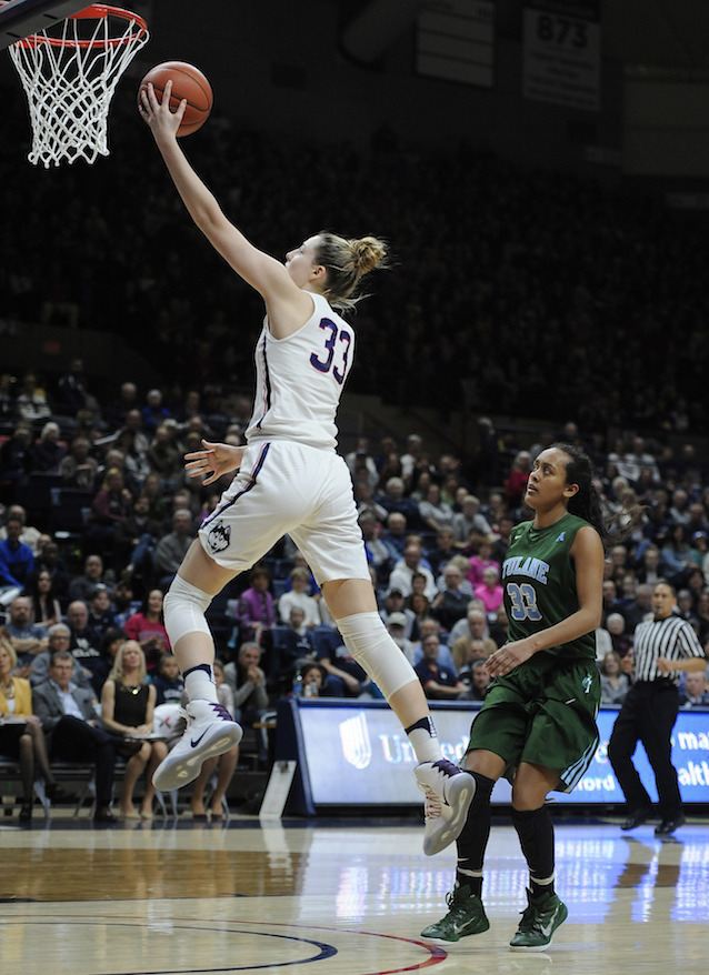Connecticut's Katie Lou Samuelson, left, goes up for a basket after a breakaway steal as Tulane's Courtnie Latham, right, looks on in the second half of an NCAA college basketball game, Sunday, Jan. 22, 2017, in Storrs, Conn. (AP Photo/Jessica Hill)