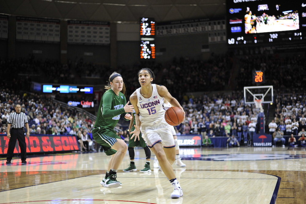 Gabby Williams drives the lane in a game against Tulane. Williams had 13 points, five rebounds, and six assists in the win. (Jason Jiang/The Daily Campus)