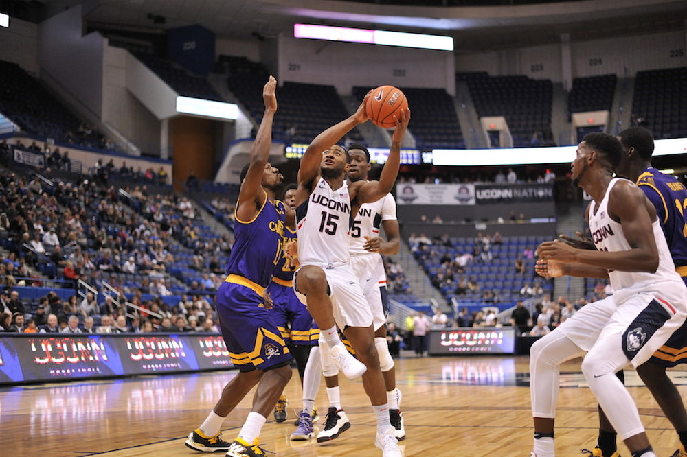 UConn's Rodney Purvis drives the lane while teammate Kentan Facey looks on in a win over ECU on January 22 at the XL Center. (Jason Jiang/The Daily Campus)