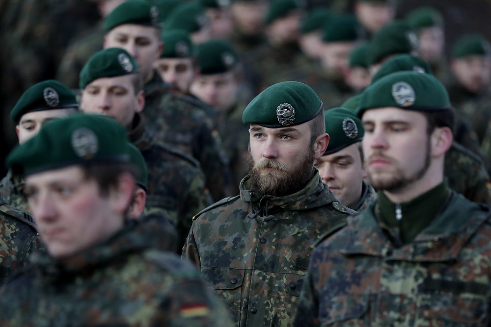 German Bundeswehr soldiers of the 122th Infantry Battalion take part in a farewell ceremony in Oberviechtach, Germany, Thursday, Jan. 19, 2017. As a part of the NATO program 'enhanced forward presence' 450 soldiers will move to Lithuania in the upcoming weeks. (AP Photo/Matthias Schrader)