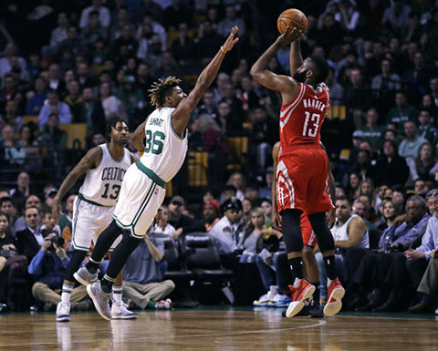 "Boston Celtics guard Marcus Smart (36) tries to block a shot by Houston Rockets guard James Harden (13) during the first quarter of an NBA basketball game in Boston, Wednesday, Jan. 25, 2017.  Our writer believes that Harden deserves the title ""Most Valuable Player"" (Charles Krupa/AP)"