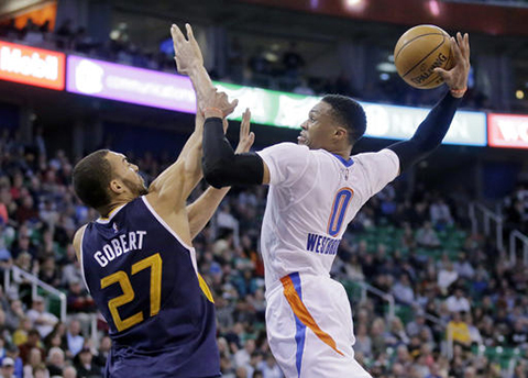 Utah Jazz center Rudy Gobert (27) defends against Oklahoma City Thunder guard Russell Westbrook (0) in the second quarter during a NBA basketball game, Monday, Jan. 23, 2017, in Salt Lake City.  Our writer believes Westbrook should have been the starter for the All-Star Game roster. (Rick Bowmer/AP)