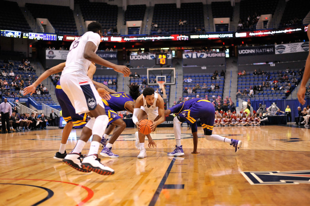 Sophomore guard Jalen Adams attempts to dodge two ECU players during the Huskies 72-65 victory over the Pirates at the XL Center on Jan. 22, 2016. (Zhelun Lang/The Daily Campus)