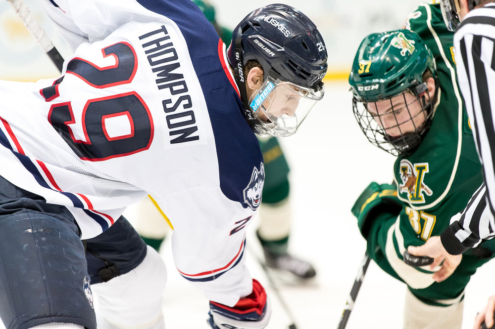 Tage Thompson squares off for a face-off with a UVM player in Friday night's game. (Owen Bonaventura/The Daily Campus)