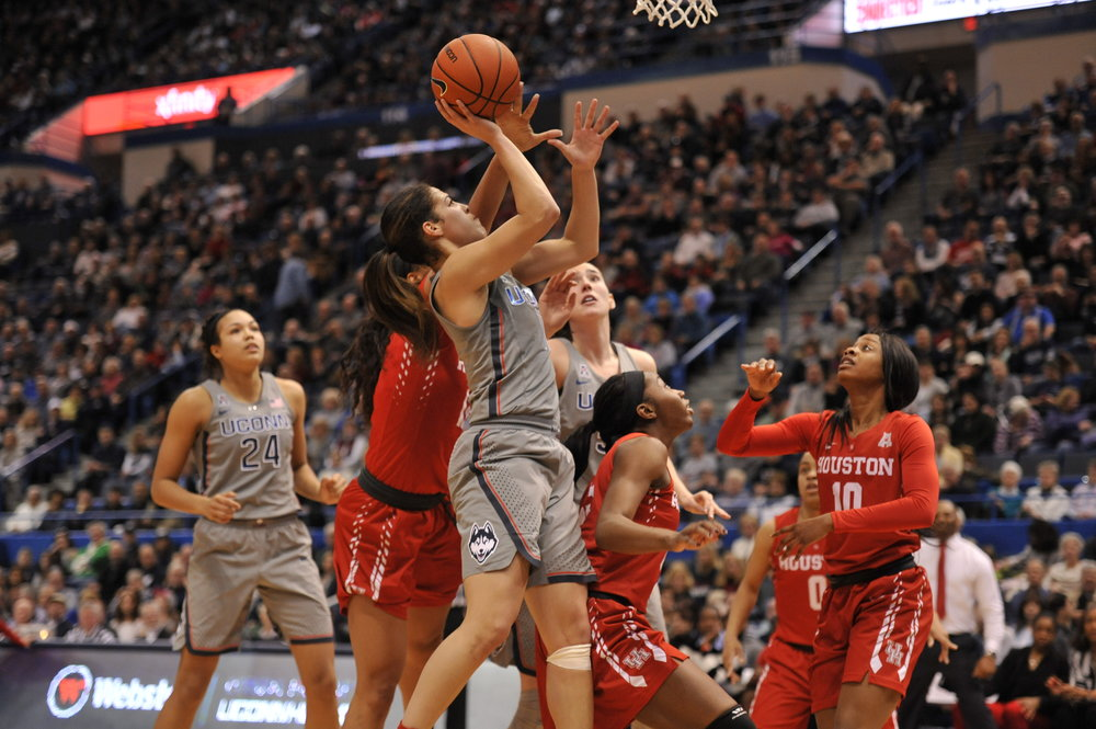 Kia Nurse gets around Houston defenders to take a lay up in the 91-42 win at the XL Center. Nurse had 16 points in the game. (Jason Jiang/Daily Campus)