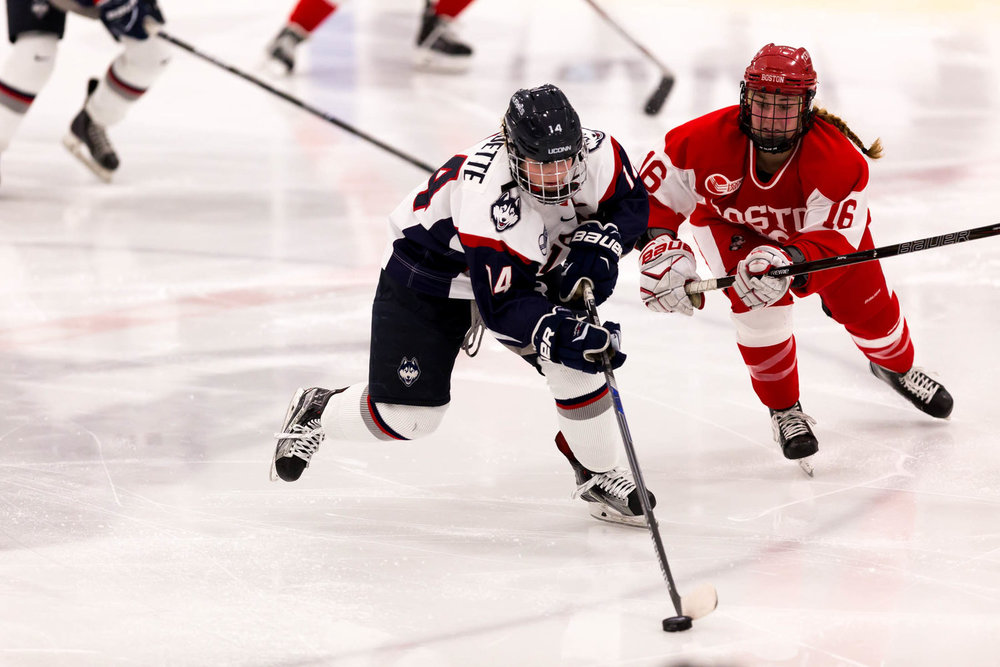 UConn forward Justine Fredette (14) manuevers past a Boston University defender during the Huskies 2-1 victory over the Terriers on Jan. 10, 2016. (Tyler Benton/The Daily Campus)