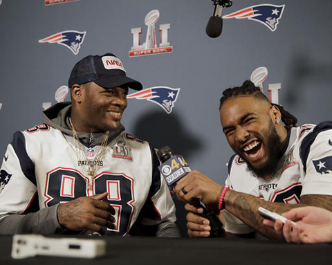 New England Patriots running back Brandon Bolden, right, interviews tight end Martellus Bennett during a media availability for the NFL Super Bowl 51 football game Wednesday, Feb. 1, 2017, in Houston. The Patriots will face the Atlanta Falcons in the Super Bowl Sunday. (Charlie Riedel/AP)