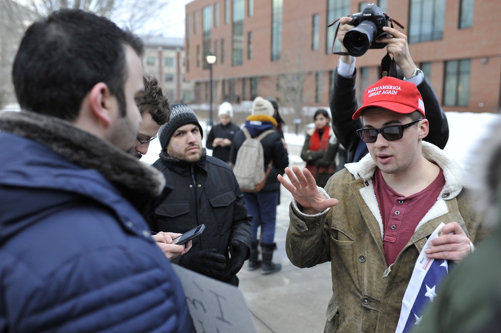 Trump supporters debate with students attending the resisTRUMP rally on the steps of the Student Union on Feb. 1. (Jason Jiang/The Daily Campus)