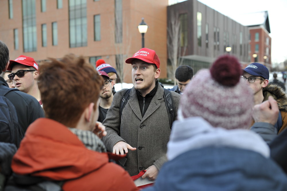 Michael Grischuk, a fifth-semester communications major and Trump supporter, debates with students attending the rally on Feb. 1. (Jason Jiang/The Daily Campus)